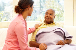 caregiver combing elderly